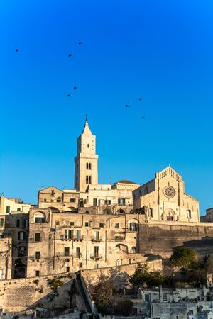 The Cathedral of Matera in the Middle of the Sassi di Matera on Blue Sky Background 版權商用圖片