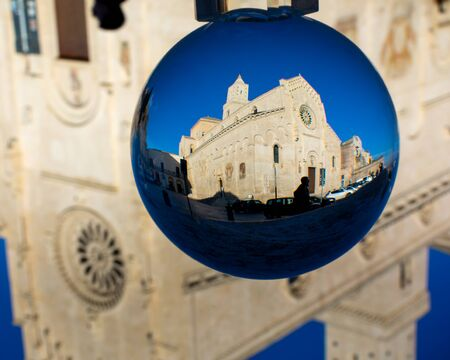 The Cathedral of Matera in a Cristal Sphere on Blue Sky Background. Cathedral of Madonna della Bruna e di SantEustachio