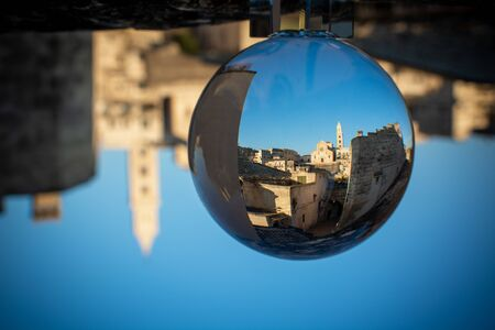 The Cathedral of Matera in Ialy in the Middle of the Sassi di Matera enlosed in a Cristal Sphere on Blue Sky Background 版權商用圖片
