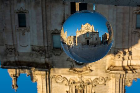 The Church of San Francesco Di Assisi in Matera enclosed in a Cristal Sphere on Blue Sky Background 版權商用圖片 - 137741757