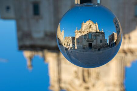 The Church of San Francesco Di Assisi in Matera enclosed in a Cristal Sphere on Blue Sky Background 版權商用圖片