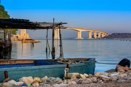 Aldo Moro Bridge in Taranto at Sunset. Ponte di Punta Penna in Mar Piccolo, Italy. Bridge on Mussil Plantation