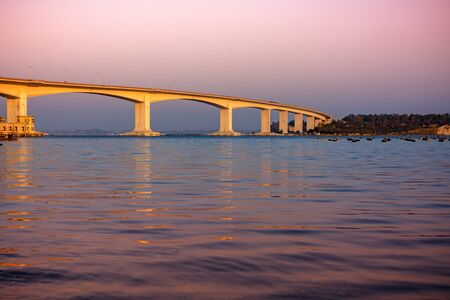 Aldo Moro Bridge in Taranto at Sunset. Ponte di Punta Penna in Mar Piccolo, Italy. Bridge on Mussil Plantation