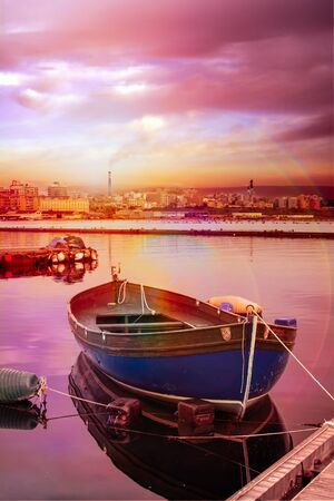 The Little Sea in Taranto at Sunset. Industrial Site on the Background with Smoke from Chimneys. Peaceful and Relaxing Background 版權商用圖片