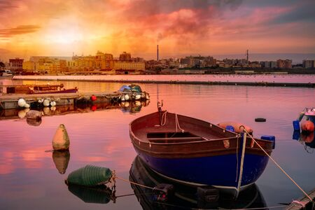 The Little Sea in Taranto at Sunset. Industrial Site on the Background with Smoke from Chimneys. Peaceful and Relaxing Background