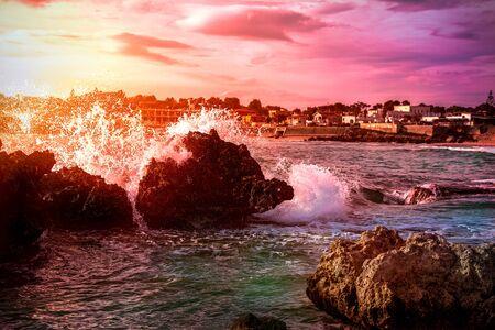 Gabbiano Beach at Sunset in  Taranto. Waves against the Rocks. Romantic Atmosphere in Mediterranean Sea Coastline