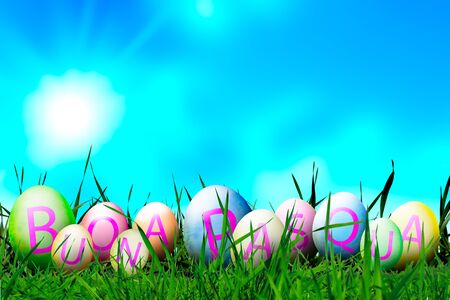 Photoshop Easter Eggs in Sunny Meadow on Blue Sky  Background with Italian Sentence Buona Pasqua, that means Happy Easter. Funny Softly Colored Eggs with Happy Easter Letters. Easter in Spring. Copy Space 版權商用圖片