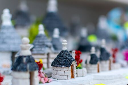 Colored souvenirs from Alberobello, South of Italy on Blurred background. Souvenir from Alberobello, the city of ancient buildings called Trulli 版權商用圖片