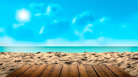 top of wooden table with blurred sea and sand background - Empty ready for your prodyct display montage. concept of beach in summer