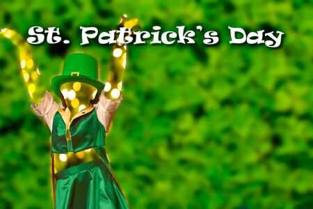 Silhouette of a girl that dress a green cap that dances  on Green Background fot saint patrick day. copy space.