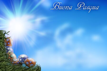 Eggs and Grass Corners on Blue Sky Background with the Italian Sentence Buona Pasqua that means Happy Easter - Copy space - concept of Easter in Spring 版權商用圖片