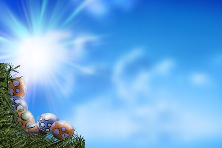 Eggs and Grass Corner on Blue Sky Background - Copy space - concept of Easter in Spring