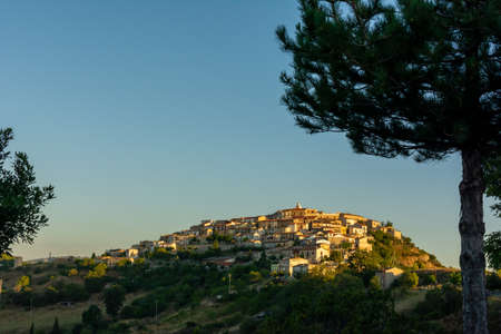 Panoramic View of the small village of Castroregio, in Basilicata, Italy. Summer Sunrise of scenic landscape of a small village in the South of Italy on Blue sky Background