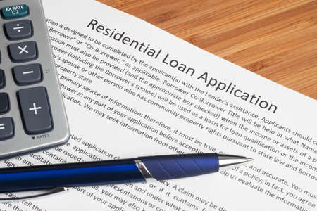 mortgage application: A house key sitting on mortgage application.