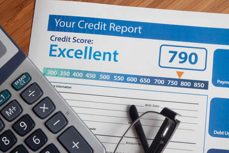 financial report: Credit report with score on a desk