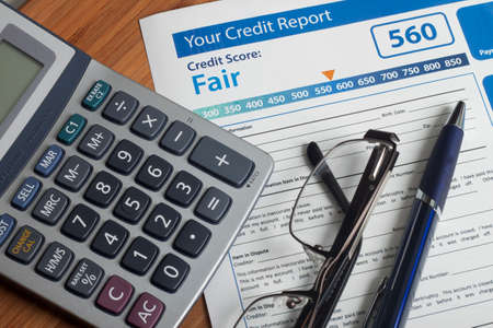 credit card debt: Credit report with score on a desk