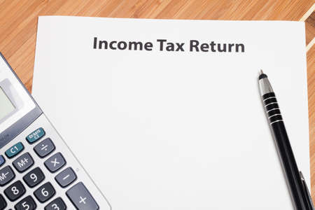 income tax: Close up U.S. taxes papers Stock Photo