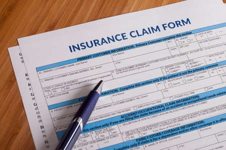 compensate: Claim form for a work injury on a desk top