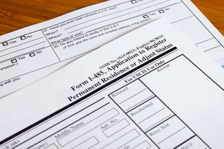 immigration: Form permanent US residence, someone filling out application form Stock Photo