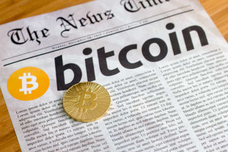 Bitcoin on newspaper background