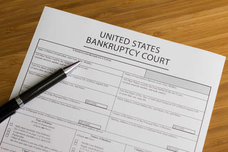 Someone fllling out Bankruptcy Court Hearing Form Stock Photo