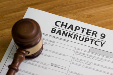 Documents for filing bankruptcy Chapter 9 Stock Photo