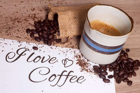 cup of coffee and bag of coffee beans closeup Stock Photo