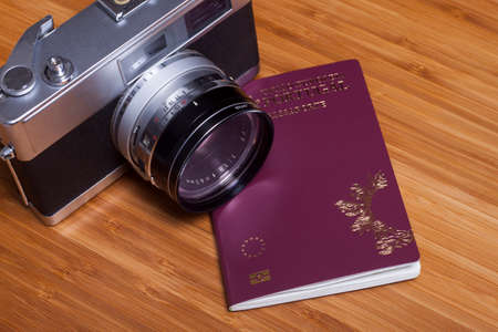 Old fashionable travel stuff and passport on wooden table Stock Photo