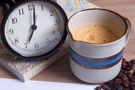 cup of coffee, clock and personal notebook closeup, coffee time