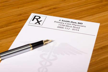 blank Prescription, pen and stethoscope on a medical desk