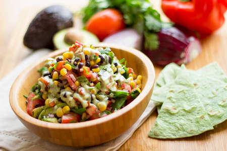 Mexican salad with cashew based garlic sauce Stock Photo