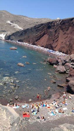 incidental people: Red volcanic beach on Santorini, Greece.
