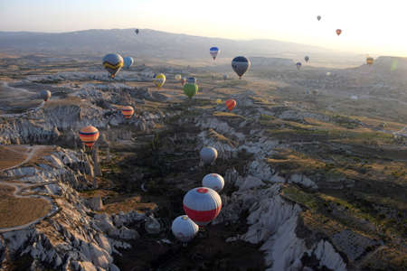 goreme: Balloon flying over Cappadocia, Turkey at sunrise