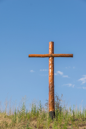 Image of cross with sun with blue sky in Claromeco, Buenos Aires