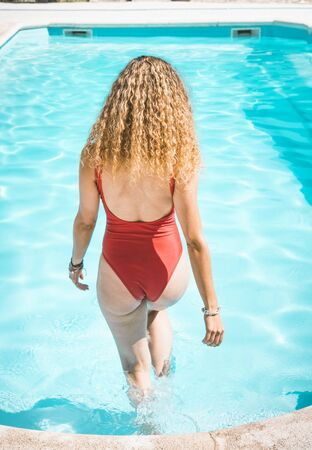 Caucasian blond woman from behind