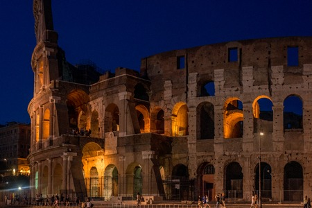 Rome, Italy - July 16, 2019: The Colosseum under the glow of lights at night, Rome Editorial