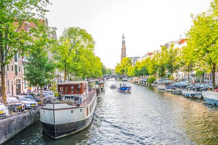 Amsterdam, Netherlands - July 19, 2018: Typical boathouses, on the Amsterdam canals Standard-Bild