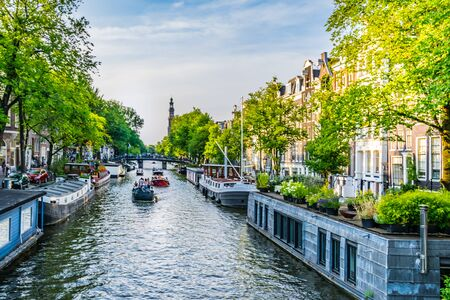 Amsterdam, Netherlands - July 19, 2018: Typical Boathouses, on the canals of Amsterdam Standard-Bild