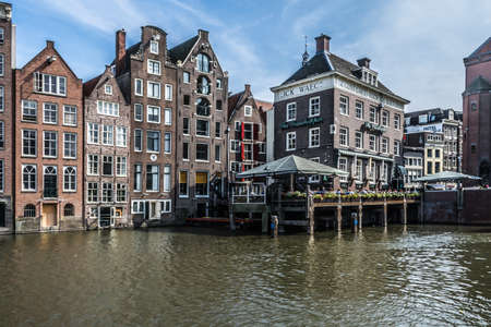 Amsterdam, Netherlands - July 19, 2018: Old canal border houses in typical Dutch architectural style along a main canal 新聞圖片