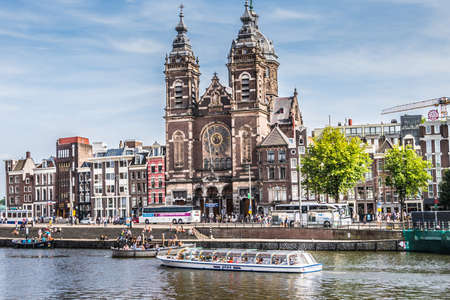 Amsterdam, Netherlands - July 19, 2018: Dutch architectural style along a main canal in Amsterdam.