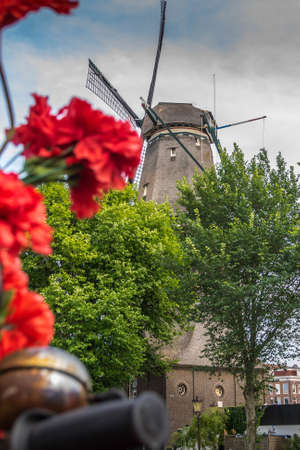 The De Gooyer Mill is located on the edge of the historic center, Amsterdam. Focus in the background 版權商用圖片
