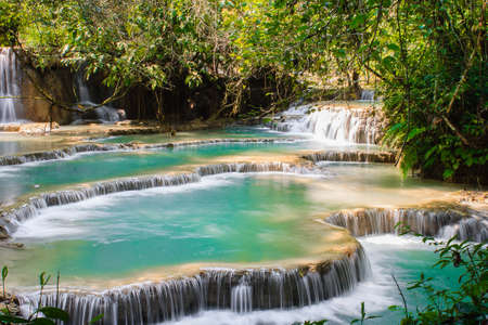 The Kuang Si Falls is a multi-level waterfall about 30 kilometers south of Luang Prabang Stockfoto