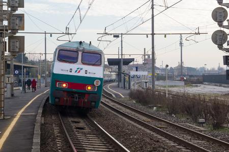 departing: PISA-ITALY: JANUARY, 24 2016: Trenitalia Regional Passenger Train is departing from a station.