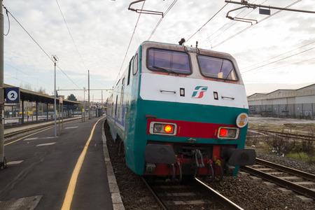 regional: PISA-ITALY: JANUARY, 24 2016: Trenitalia Regional Passenger Train is departing from a station.