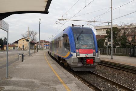 diesel train: Pisa-ITALY: JANUARY, 24 2016: Trenitalia Diesel Train Model ATR 220 Swing Is Departing from Station