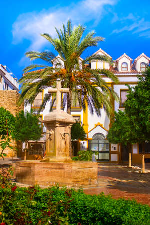 cobbled: Church Square Tranquil Scenery in the Old Town of Marbella Stock Photo