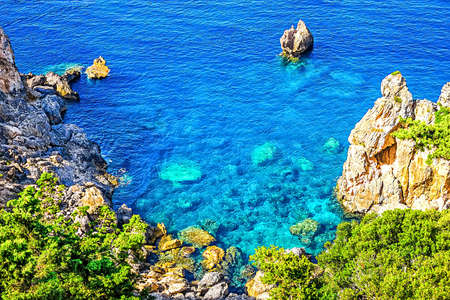 Cliffside coastline on Greek island Corfu photo
