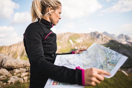 Adventurous mountain girl surrounded by beautiful mountains Фото со стока