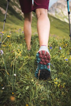 Adventurous Sportive Girl hiking in Beautiful Alpine Mountains