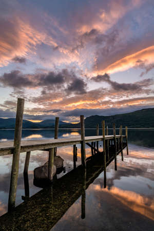Dramatic sunrise over Brandlehow Jetty in the Lake District, UK.